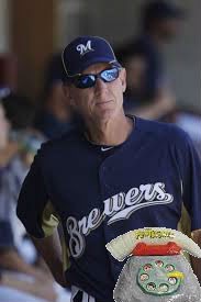 Ron Roenicke seen attempting to call the bullpen.